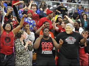 Rogers fans get into the excitement of the Lady Rams tournament action.