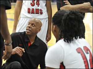 Lady Rams head coach Lamar Smith gives some words of encouragement to his team.