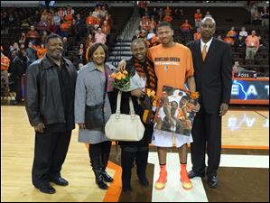 Bowling Green senior basketball player A'uston Calhoun, with godparents Mario and Carla Lewis, mother La'Tanya Calhoun, and coach Loius Orr, is honored prior to the Falcon's  game against Buffalo.