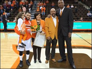 Bowling Green senior basketball player Jordan Crawford, holding his daughter, Alaynah, with his parents Kelle and Donald Crawford, and coach Loius Orr, is honored.