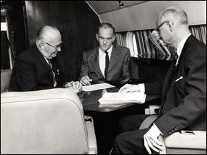 In the corporate jet from left to right Larry Mankin, Roy Hummel and T.H. Hill. Company unknown.