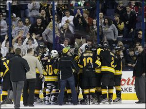 Northview's team and fans gather at their goal as they are cheered after the game.