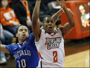 Bowling Green's Anthony Henderson is fouled by  Buffalo's Jarryn Skeete as he shoots.
