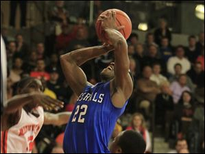 Anthony Wayne's Ose Omofoma splits the Mansfield defenders to put a shot up.