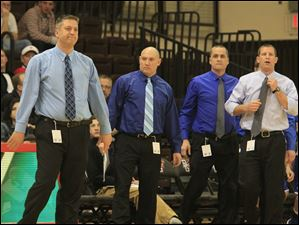 Anthony Wayne coach Bryan Borcherdt, left, and assistants watch the action early in the game.