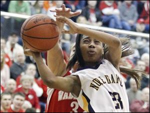 Notre Dame's Christiana Jefferson (23) goes to the hoop past Wadsworth's Taylore Robinnson.