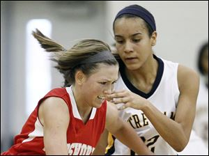 Notre Dame's Jayda Worth (22) defends  against Wadsworth's Peyton Booth.
