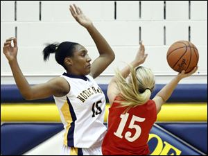 Notre Dame's Kaayla McIntyre (15) defends against  Wadsworth's Jody Johnson (15).