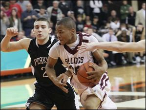 Perkins' Mitchell Benkey chases Scott's  Bryson Collins in transition.