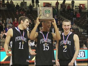 Perkins players Brandon Smith, left, Nic Williams, and David Doster hoist the hardware after their win.