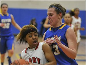 Lady Rams Cha'ron Sweeney drives against Clydes amanda Cahill in Tournament action at Ontario on Friday.