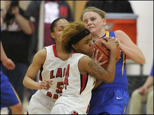 Rams point guard Cha'ron Sweeney struggles with Clydes Lexi Weber for ball control as teammate Keynna Austin tries to help.