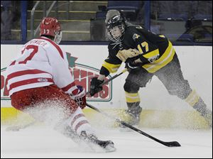 Northview senior Nick LaPlante (17) attempts to retain control of the puck during the first period.