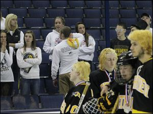 Northview students watch as their team embraces after the game.