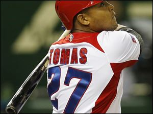 Cuba's rightfielder Yasmany Tomas hits a three-run homer off Taiwan's pitcher Yang Yao-hsun in the fourth inning of their World Baseball Classic second round game at Tokyo Dome in Tokyo, Saturday, March 9, 2013. (AP Photo/Koji Sasahara)