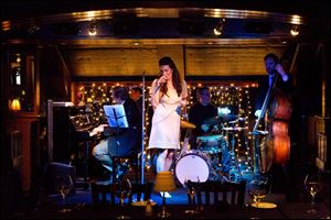 Nicole New, of Detroit, center, sings with the Scott Gwinell Trio on Friday evening. The restaurant features a jazz trio or a classical pianist five nights a week, and dancing as the night goes on.
