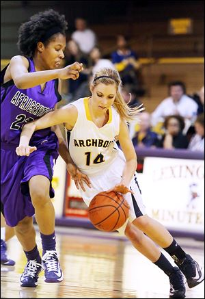 Africentric's Sierra Harley pressures Taylor Coressel in the third quarter. Coressel scored nine points in her final high school game.