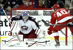 Blue Jackets goalie Sergi Bobrovsky stops a shot by the Red Wings' Henrik Zetterberg in the second period en route to his first shutout. He f