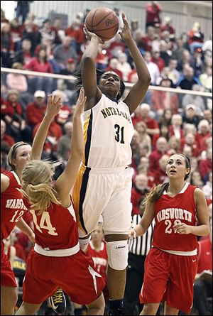 Notre Dame's Tierra Floyd shoots over Wadsworth's Hannah Centea. Floyd led the Eagles (25-3) with 20 points. Notre Dame plays Friday against Kettering Fairmont in the state semifinals at Ohio State's Schottenstein Center.