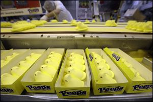 Peeps move through the manufacturing process, at the Just Born factory in Bethlehem, Pa. With the storied candy brand celebrating its 60th anniversary this year, a quirky new TV ad campaign talks about all the things people do with their Peeps.