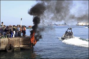 Several protesters set fire to tires on the city's dock today in an attempt to prevent ships from coming in to the strategic city of Port Said at the Mediterranean end of the Suez Canal, in Egypt.
