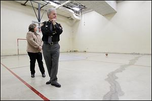 Lucas County Commissioner Carol Contrada and Sheriff John Tharp examine the damaged recreation area at the jail. A month ago, a rusty pipe burst in the ceiling of the gymnasium, spewing discarded food and other kitchen waste on the gym floor.