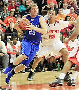 Anthony Wayne's Hunter Johnson drives around Jalen Reese.  The Generals are 20-4.