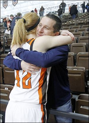 Bowling Green's Danielle Havel hugs former Falcons coach Curt Miller. Miller left BG after last year to take the top job at Indiana.
