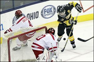 Northview's  Zander Pryor (19) attempts to score during the third period against Shaker Heights goalie Eric Sterin.