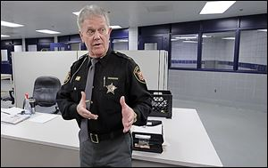 Sheriff John Tharp speaks about how crowded it gets in the booking area at the Corrections Center.