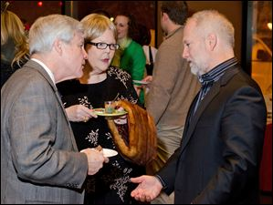 From left, Gene and Judy Pearson talk with guest speaker, award winning chocolatier, Shawn Askinoise, founder of Askinoise Chocolates.