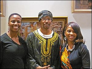 From left, Nicole Rice, Joshua Bey, and Bonita Adams enjoy the sounds and the performers that honored Black History.