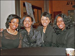 From left, Richelle Watkins, Deborah Porter, Tonya Rider and Kerry Emery attend the Chocolate Soiree presented by the Junior League of Toledo.