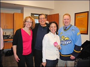 Breast imaging radiologists Tamara Martin, left, Robing Shermis, left center, and Malcolm Doyle, right, with breast cancer survivor Debbie Knight, right center at the Walleye's Pink The Rink breast cancer awareness weekend at the Huntington Center.