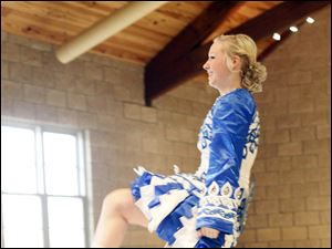Brenna Kummer of the Ardan Academy of the Irish Dance performs.