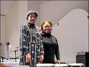 LaCarmen Waters, left, and Robin Smith thumped on African drums at the Our Rhythm, Our Voices program at the WordUP Drama Ministry of Friendship Baptist Church.