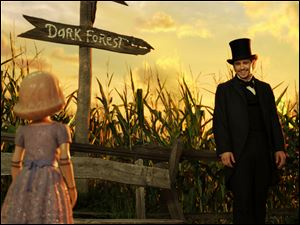 This film image released by Disney Enterprises shows the character China Girl, voiced by Joey King, left, and James Franco, as Oz, in a scene from 'Oz the Great and Powerful.'