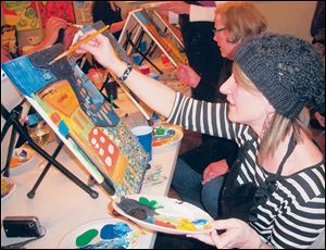 Cari Freeman works on her replica of a Van Gogh painting.