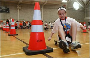 Mia McCartney of North Baltimore skirts a cone in the Scooter Slalom Saturday in the Wood County Youth Olympics at Bowling Green State University.