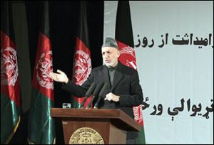 Afghan President Hamid Karzai holds a news conference in Kabul on Sunday in honor of  Women's Day. He later met privately with Defense Secretary Chuck Hagel, who is making his first official visit there.