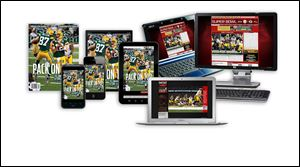 A copy of Sports Illustrated magazine, left, is shown as Sports Illustrated digital subscriptions are displayed on smartphones, tablets, laptops, and a desktop computer. Time Warner Inc. on said that it will spin off the magazine unit behind Time, Sports Illustrated, and People into a separate, publicly traded company by the end of the year.