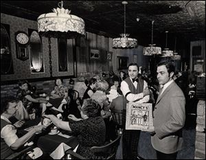 In May, 1968, customers dine under Tiffany lamps at Mancy's Ideal Restaurant. The lamps were added, along with circus posters and a pot-bellied stove, about 1964.