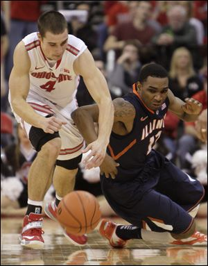 Ohio State's Aaron Craft, left, and Illinois' Tracy Abrams chase a loose ball during the second half Sunday in Columbus. Craft had 14 points and six assists for the Buckeyes in their win against Illinois.