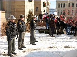 Jefferson Co. sheriff's deputies stand nearby during the  protest at the Jefferson County Courthouse in Steubenville, Ohio, on Jan. 5. Tensions within the town have not subsided with time.