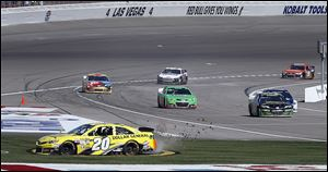 Matt Kenseth (20) spins out across the infield after winning at Las Vegas Speedway on Sunday.