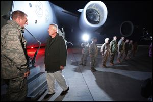 Defense Secretary Chuck Hagel prepares to step aboard a C-17 military aircraft en route to Kabul, Afghanistan, after greeting U.S. troops stationed at Manas Air Force Base in Kyrgyzstan.