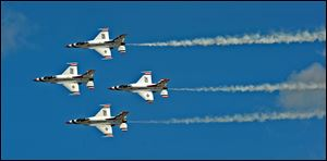 Members of the U.S. Air Force Thunderbirds perform at the Air Expo 2012 at Joint Base Lewis McChord, Wash.