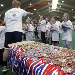 Medals await the winners. Organizers said a total of 280 were awarded; youths competed in 10 events.