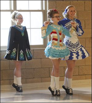 From left, Mary-Catherine Scarett, Maegan Fleniken, and Brenna Kummer of the Ardan Academy of the Irish Dance perform Sunday during a festive night celebrating St. Patrick's Day at St. Joseph East Campus.