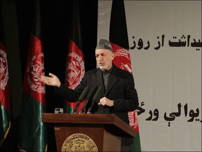 Afghan President Hamid Karzai speaks during a nationally televised speech about the state of Afghan women in Kabul, Afghanistan, today.